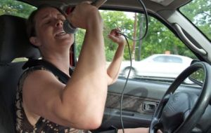 nissan_woman_singing_rocking_out_in_car_chad_grayot